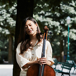 Cellist Soomin Suh posing in the Maurice Gardette Square. Paris, France. July 1st, 2019.<br /> La violoncelliste cellist Soomin Suh, prenant la pose au square Maurice Gardette. Paris, France. 1er juillet 2019.