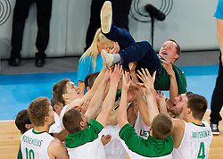 Players of Lithuania celebrate with Kazys Maksvytis, head coach of Lithuania after the basketball match between National teams of Lithuania and France in final match of U20 Men European Championship Slovenia 2012, on July 22, 2012 in SRC Stozice, Ljubljana, Slovenia. Lithuania defeated France 50-49 and became European Champion 2012. (Photo by Vid Ponikvar / Sportida.com)