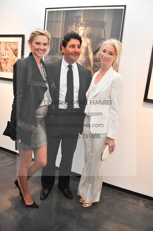Left to right, MALIN JEFFERIES, GEORGIO VERONI and TAMARA BECKWITH at a private view of photographs by Herb Ritts held at Hamiltons Gallery, 13 Carlos Place, London on 21st June 2011.