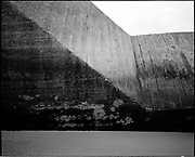 THE ATLANTIC WALL. .pic shows: DESTROYED WALL AT WISSANT BETWEEN CALAIS AND BOULOGNE. SHOWING WOODGRAIN IN THE CEMENT FORMED DURING CONSTRUCTION..WORLD WAR TWO ENDED IN EUROPE IN MAY 1945, THIS YEAR SEES THE 60th ANNIVERSARY OF THAT VICTORY..THE ATLANTIC WALL BUILT BY GERMANY IN WORLD WAR 2 STRETCHED FROM NORWAY VIA DENMARK, HOLLAND, BELGIUM AND FRANCE TO THE SPANISH BORDER. THE MAIN CONCENTRATION OF BUNKERS,BLOCKHOUSES AND DEFENCES WERE ALONG THE DUTCH, BELGIAN AND FRENCH COASTAL AREAS MOST UNDER THREAT FROM AN ALLIED INVASION. THE CONSTRUCTION OF THE WALL BEGAN IN 1942 AND CONTINUED UP UNTIL THE JUNE 6th ALLIED INVASION ON D-DAY IN 1944..TENS OF THOUSANDS OF WORKERS AND PRISONERS FROM THE GERMAN OCCUPIED AREAS OF EUROPE WERE EMPLOYED BY THE ORGANISATION TODT NAMED AFTER FRITZ TODT, THE GERMAN ENGINEER WHO DIED IN 1942 (TO BE SUCEEDED BY ALBERT SPEER) IN THE BUILDING WORK. BETWEEN THE RIVERS LOIRE AND DIVES 87,257 WORKERS WERE USED INCLUDING 55,000 FRENCHMEN, 11,500 GERMANS, 4,200 DUTCH, 6.600 BELGIANS, 2,600 NORTH AFRICANS AND SEVERAL THOUSAND FROM EASTERN EUROPE..THE ATLANTIC WALL WAS THE LARGEST BUILDING PROJECT SINCE THE ROMAN EMPIRE. MANY OF THE COLOSSAL GUN BUNKERS AND UNDERGROUND DEFENSIVE CHAMBERS REMAIN. SOME HAVE FALLEN FROM CLIFF TOP POSITIONS WHILE OTHERS ARE PARTLY CONSUMED BY SAND DUNES. THE RAVAGES OF WAR, TEN THOUSAND TON BOMBS AND 60 YEARS OF COASTAL WEATHER HAVE HARDLY AFFECTED THESE LEVIATHAN LIKE STRUCTURES WHICH LOOK LIKELY TO LAST AS LONG AS THE RUINS OF ANCIENT ROME. A FITTING REMINDER OF A WORLD THAT COULD HAVE BEEN FROM 60 YEARS AGO..COPYRIGHT PHOTOGRAPH BY BRIAN HARRIS  © 2005.07808-579804