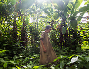"""Jose, in his """"Chaco"""", his plantain field that he planted, using slash-and-burn technic. House of Jose, 75, one of the oldest Tsimane. He is the only Tsimane still wearing a cojchity, the traditional Tsimane cloth."""