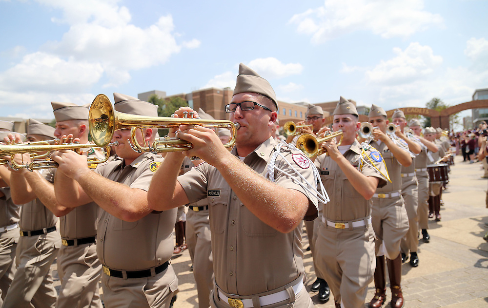 Members of the Texas A&M Corps of Cadets file towards Kyle Stadium before the start of an NCAA college football game between Texas A&M and UCLA on Saturday, Sept. 3, 2016, in College Station, Texas. (AP Photo/Sam Craft)