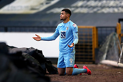 Coventry City's Maxime Biamou appeals to the referee after being bundled from the pitch