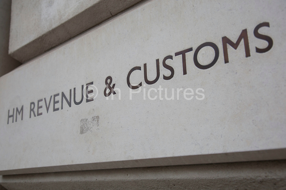 HM Revenue & Customs also known as HMRC sign outside their offices in Whitehall, London. This organisation is in charge of all elelments of tax and taxation as well as administering corporation tax, excise duties, national minimum wage enforcement, recovery of student loans, child benefit etc.