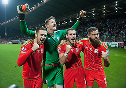 ZENICA, BOSNIA & HERZEGOVINA - Saturday, October 10, 2015: Wales Gareth Bale with Joe Ledley, Aaron Ramsey and Wales goalkeeper Wayne Hennessey celebrate after securing a place at next years Euro Championships after the Bosnia & Herzegovina vs Wales match at the Stadion Bilino Polje during the UEFA Euro 2016 qualifying Group B match. (Pic by Peter Powell/Propaganda)