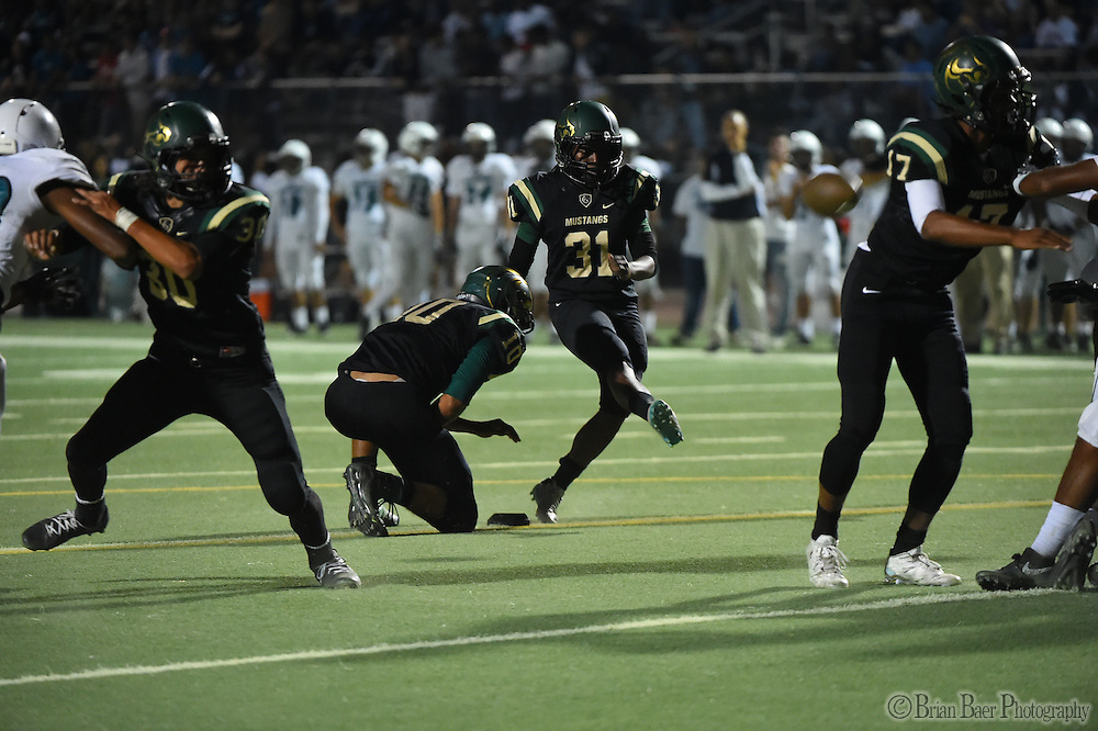 Monterey Trail Mustangs female kicker Tehya Beadles (31), kicks the point after attempt during the first quarter as the Monterey Trail Mustangs host the Sheldon High School Huskies Friday Sep 23, 2016.<br /> photo by Brian Baer