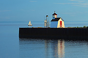 Wood Islands Light Station and sailboat on the  Northumberland Strait<br /> Wood Islands<br /> Prince Edward Island<br /> Canada
