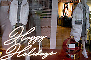 In advance of a re-opening of businesses and before a change to a Tier 2 for London during the second wave of the Coronavirus pandemic, a closed clothing retailer wishes its customers Happy Holidays, on 30th November 2020, in London, England. Retailers will once again be open for Christmas business on 3rd December.
