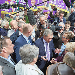 © Licensed to London News Pictures.  30/04/2015. AYLESBURY, UK. Nigel Farage (centre right), UKIP party leader, talks to potential voters during a campaign visit to Aylesbury. Photo credit: Cliff Hide/LNP