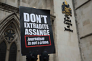 A placard placed by supporters of Wikileaks founder Julian Assange outside the High Court following a March for Assange from BBC Broadcasting House organised by the Dont Extradite Assange campaign is pictured on 23rd October 2021 in London, United Kingdom. The US government will begin a High Court appeal on 27th October against a decision earlier this year not to extradite Assange to face espionage charges in the United States. Assange has been held in Belmarsh Prison since 2019.