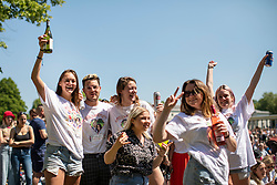 © Licensed to London News Pictures. 19/05/2018. London, UK. Well-wishers watch the Royal Wedding at an outdoor screening at the National Maritime Museum in Greenwich. Prince Harry is getting married to Meghan Markle today in Windsor. Photo credit: Rob Pinney/LNP