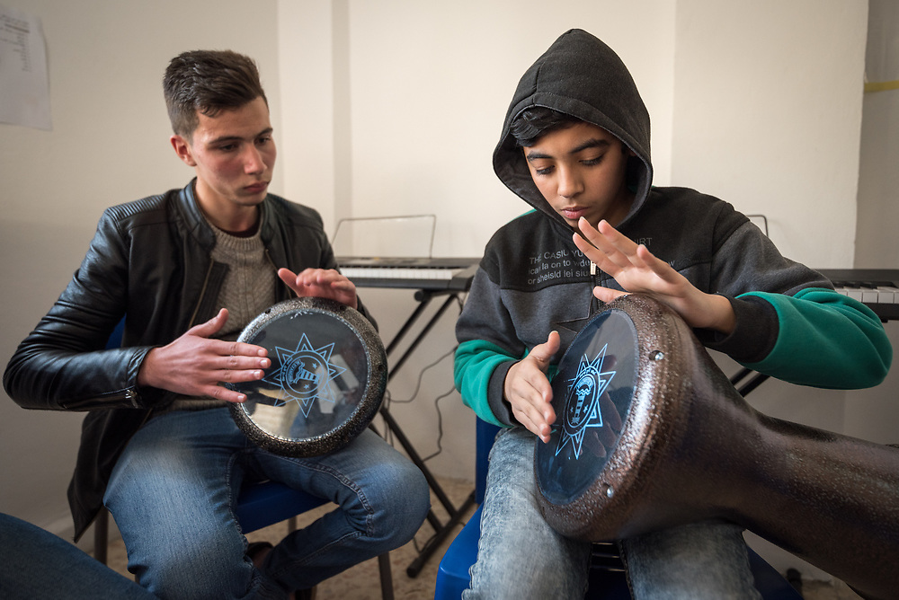 17 February 2020, Zarqa, Jordan: Music class at the Lutheran World Federation community centre in Zarqa. Through a variety of activities, the Lutheran World Federation community centre in Zarqa serves to offer psychosocial support and strengthen social cohesion between Syrian, Iraqi and other refugees in Jordan and their host communities.