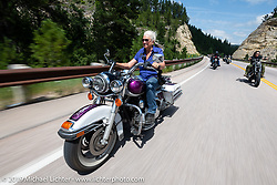 Cheryl O'Brien riding on the Cycle Source Ride up Vanocker Canyon to Nemo during the Sturgis Black Hills Motorcycle Rally. SD, USA. Wednesday, August 7, 2019. Photography ©2019 Michael Lichter.