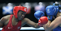 Glasgow, Scotland - July 28: <br /> <br /> Boxing on Day 6 of the Glasgow 2014 Commonwealth Games at The SECC on July 28, 2014 in Glasgow, Scotland. <br /> <br /> Women's Middle, Elizabeth Adhiambo ANDIEGO ( KEN ) Vs Kaye SCOTT ( AUS )<br /> (Photo  by Marc Turner/Capture The Event)