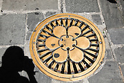 Floral clove design on a manhole cover in Portofino, Liguria,  Italy