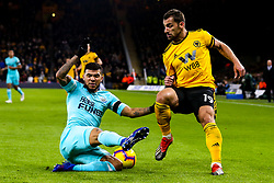Jonny of Wolverhampton Wanderers is tackled by DeAndre Yedlin of Newcastle United - Mandatory by-line: Robbie Stephenson/JMP - 11/02/2019 - FOOTBALL - Molineux - Wolverhampton, England - Wolverhampton Wanderers v Newcastle United - Premier League