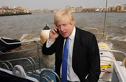 London Mayor Boris Johnson rides aboard a Thames Clipper from Tower Bridge to Greenwich. Plans to improve river services on the Thames, including better ticket arrangements, were announced today by London Mayor Boris Johnson.