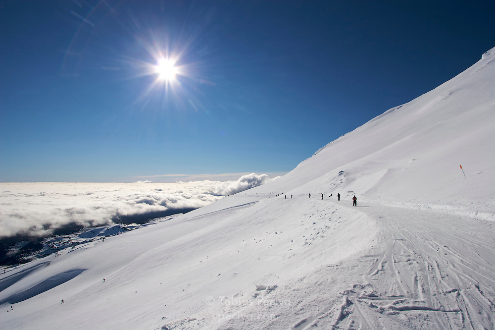 Trail traversing along the top of ski field Turoa. Turoa is located on active volcano Mount Ruapehu, New Zealand.