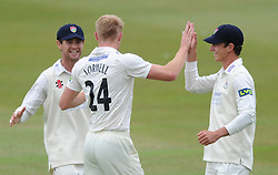 Will Tavare of Gloucestershire celebrates with bowler Liam Norwell as Chris Dent of Gloucestershire catches out Rob Keogh of Northamptonshire - Photo mandatory by-line: Dougie Allward/JMP - Mobile: 07966 386802 - 08/07/2015 - SPORT - Cricket - Cheltenham - Cheltenham College - LV=County Championship 2