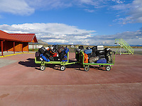 Luggage Carts Outside the Puerto Natales Regional Airport Terminal. Snapshot taken with a Leica D-Lux 5 camera (ISO 80, 5.1 mm, f/4, 1/800 sec).