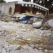 Pictured are remains of a training centre for nurses next to Central Hospital. The building collapsed with an estimated 80 people still inside. Government buildings were particularly hard hit in the earthquake for example 87 percent of schools in Port Au Prince  are destroyed. In the foreground the remains of a person still lie. A month after the quake most remains but not all have been cleared from the streets. Inside the buildings very few bodies have been cleared such is the enormity of the task.