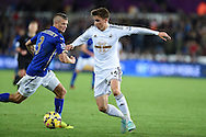 Tom Carroll of Swansea city in action. Barclays Premier league match, Swansea city v Leicester city at the Liberty stadium in Swansea, South Wales on Saturday 25th October 2014<br /> pic by Andrew Orchard, Andrew Orchard sports photography.