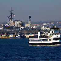USA, California, San Diego. The San Diego Coronado Passenger Ferry and the USS Midway.