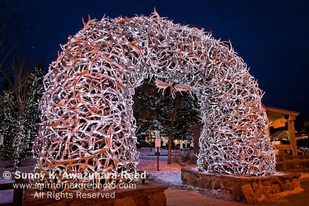 Lighted up on Antler Arch at night.  Town Square, Jackson Hole, WY.  Winter Scene.