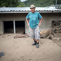 Francisco Lara walks around his house that is badly damaged by the flooding from hurricanes Eta and Iota in San Pedro Sula, Honduras.