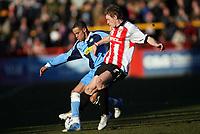 Danny Senda left for Wycombe, Brian Wilson right for Cheltenham<br /> <br /> Photo: Richard Eaton.<br /> <br /> Cheltenham Town v Wycombe Wanderers. Coca Cola League 2. 04/03/2006.