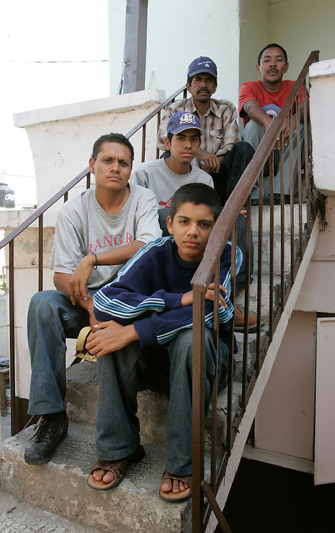 Photo by Alex Jones..A group of Nicaraguan immigrants wait at Albergue Guadalupe in Reynosa on Tuesday afternoon after a failed attempt at crossing into the United States the night before.  Clockwise from lower right: Eloy Sandoval, age 14, Ronald Quiroz, age 28, Eddy Sandoval, age 18, Juan Sandoval, age 41, and Victor Diaz, age 39.  Pedro Javier Rodriguez left Managua with them on March 16, but disappeared when the group was attacked on Monday night while trying to cross the Rio Grande near the Hidalgo International Bridge.