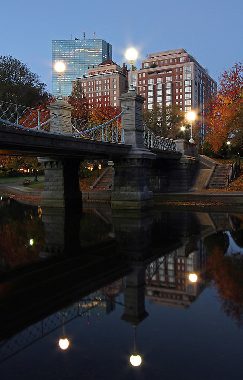 Boston twilight photography of the historic Boston Public Garden Lagoon Bridge photographed on a magical autumn morning in November.<br /> <br /> The bridge crossing the lagoon in the Boston Public Garden was designed by William G. Preston and opened in 1867. It was the shortest functioning suspension bridge in the world before its conversion to a girder bridge in 1921. Nowadays the original suspension system is purely decorative.<br /> <br /> This Boston fall foliage photography picture of the famous Boston Public Garden Lagoon Bridge is available as museum quality photography prints, canvas prints, acrylic prints or metal prints. Prints may be framed and matted to the individual liking and decorating needs:<br /> <br /> http://juergen-roth.artistwebsites.com/featured/boston-public-garden-lagoon-bridge-juergen-roth.html<br /> <br /> Good light and happy photo making! <br /> <br /> Juergen <br /> www.RothGalleries.com <br /> www.ExploringTheLight.com<br /> http://whereintheworldisjuergen.blogspot.com<br /> @NatureFineArt<br /> https://www.facebook.com/naturefineart