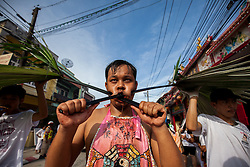 October 8, 2016 - Phuket, Phuket, Thailand - Devotees of the Chinese Ka thu shrine takes with his mouth pierced with spikes takes part in a procession celebrating the annual vegetarian festival in Phuket, Thailand, on October 8, 2016. (Credit Image: © Panupong Changchai/NurPhoto via ZUMA Press)