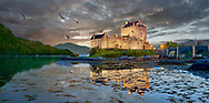 Towering Delusions  Eilean Donan Castle is on a small island in  Kyle of Lochalsh loch, Scotland. Photagraphed at sunset in its atmospheric setting backed by the Scotish mountains. By photographer Paul E Williams.<br /> <br /> Visit our LANDSCAPE PHOTO ART PRINT COLLECTIONS for more wall art photos to browse https://funkystock.photoshelter.com/gallery-collection/Places-Landscape-Photo-art-Prints-by-Photographer-Paul-Williams/C00001WetsxVxNTo
