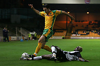 Photo: Paul Thomas.<br /> Port Vale v Norwich City. Carling Cup. 24/10/2006.<br /> <br /> Jason Shackell of Norwich beats Akpo Sodje (R) to the ball.