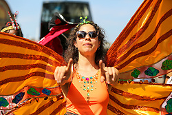 © Licensed to London News Pictures. 25/08/2019. London, UK. Dancers and children parade on family day of Notting Hill Carnival in West London. Thousands of revellers take part in Notting Hill Carnival, Europe's largest street party and a celebration of Caribbean traditions and the capital's cultural diversity. Photo credit: Dinendra Haria/LNP