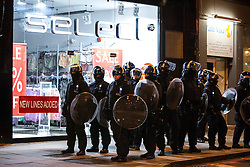 © Licensed to London News Pictures . 09/08/2011 . London , UK . Police in Camden Town during a 3rd night of rioting and looting in London , which followed a protest against the police shooting of Mark Duggan in Tottenham . Photo credit : Joel Goodman/LNP