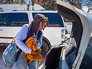 "13 MARCH 2020 - DES MOINES, IOWA: MYIA SIMS, a student at Drake University, walks to her car without her suitcase before going home for spring break. The Governor of Iowa announced Friday that 17 people in Iowa have tested positive for the Novel Coronavirus. Of those, 15 people were exposed on the same cruise in Egypt, the others were exposed through travel but were not on the same cruise. The Governor said there has not yet been any ""community spread"" in Iowa. All of the Iowans who have tested positive are in self quarantine. Across Iowa, municipalities and businesses are taking steps to implement ""social distancing."" Most of the colleges in Iowa, including Drake University, have announced that they will remain closed after their spring breaks and that classes will move to online only, after spring break. Many businesses in Des Moines, including Nationwide Insurance and EMC Insurance, have announced plans to have their employees to telecommute. The mayor of Des Moines has urged event planners to consider canceling large events.     PHOTO BY JACK KURTZ"
