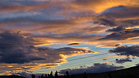 Clouds at Dusk on the way to the El Calafate in Argentina. Image taken from a moving bus with a Fuji X-T1 camera and 55-200 lens (ISO 400, 55 mm, f/10, 1/125 sec).