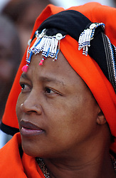 PRETORIA, SOUTH AFRICA - APRIL-27-2004 - An African woman dressed in traditional clothes for the inauguration ceremony for South African President Thabo Mbeki , which marks the 10th Anniversary of the fall of Apartheid in South Africa. (PHOTO © JOCK FISTICK)