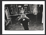 LORD NEWALL, under a limbo dancer, Party given by Mrs. Yousof Mazandi, Chester Sq. London. 6 May 1982.. Exhibition in a Box