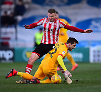 Lincoln City's Michael O'Connor battles with Northampton Town's Timi Elsnik<br /> <br /> Photographer Andrew Vaughan/CameraSport<br /> <br /> The EFL Sky Bet League Two - Lincoln City v Northampton Town - Saturday 9th February 2019 - Sincil Bank - Lincoln<br /> <br /> World Copyright © 2019 CameraSport. All rights reserved. 43 Linden Ave. Countesthorpe. Leicester. England. LE8 5PG - Tel: +44 (0) 116 277 4147 - admin@camerasport.com - www.camerasport.com