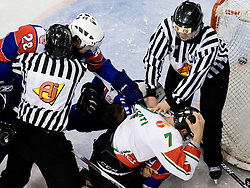 Marcel Rodman of Slovenia helps his brother David Rodman agains Omar Ennaffati of Hungary at IIHF Ice-hockey World Championships Division I Group B match between National teams of Hungary and Slovenia, on April 23, 2010, in Tivoli hall, Ljubljana, Slovenia. (Photo by Matic Klansek Velej / Sportida)