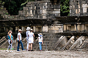 Tourists view the Great Xicalcoliuhqui or Great Enclosure at the pre-Columbian archeological complex of El Tajin in Tajin, Veracruz, Mexico. El Tajín flourished from 600 to 1200 CE and during this time numerous temples, palaces, ballcourts, and pyramids were built by the Totonac people and is one of the largest and most important cities of the Classic era of Mesoamerica.