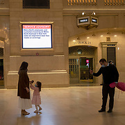 A man snaps a photo as Grand Central station remains virtually empty with closed businesses and limited traffic due to the Coronavirus (Covid-19) outbreak in New York City on Monday, May 11, 2020.  Nonessential businesses have been closed and large gatherings have been banned across the state since March 22 under an emergency order issued by Governor Cuomo that is set to expire on Friday. (Alex Menendez via AP)f