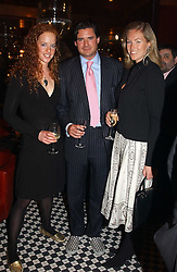 Left to right, ALICIA FOX-PITT, EDWARD TAYLOR and MARINA HUNT at a party to celebrate the launch of Ladies' Day at The Vodafone Derby Festival held at Frankie's Bar & Grill, 3 Yeomans Row, London SW7 on 19th April 2005.<br /><br />NON EXCLUSIVE - WORLD RIGHTS