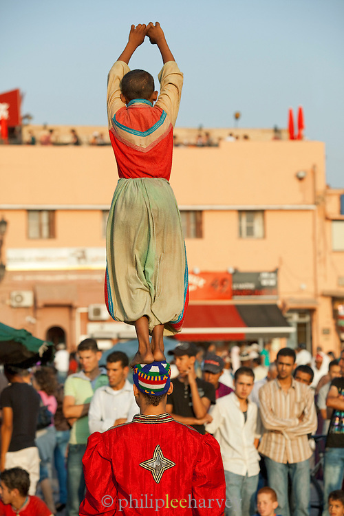Acrobats perform to the crowds on the Djemaa el Fna in the medina of Marrakech, Morocco