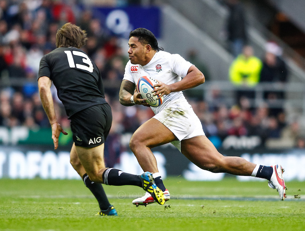 Picture by Andrew Tobin/SLIK images +44 7710 761829. 2nd December 2012. Manu Tuilagi goes past Conrad Smith (13) during the QBE Internationals match between England and the New Zealand All Blacks at Twickenham Stadium, London, England. England won the game 38-21.