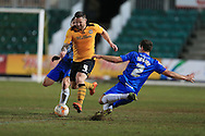 Darren Jones of Newport county © is challenged byCarl Magnay of Hartlepool. Skybet football league two match, Newport county v Hartlepool Utd at Rodney Parade in Newport, South Wales on Tuesday 15th March 2016.<br /> pic by Andrew Orchard, Andrew Orchard sports photography.