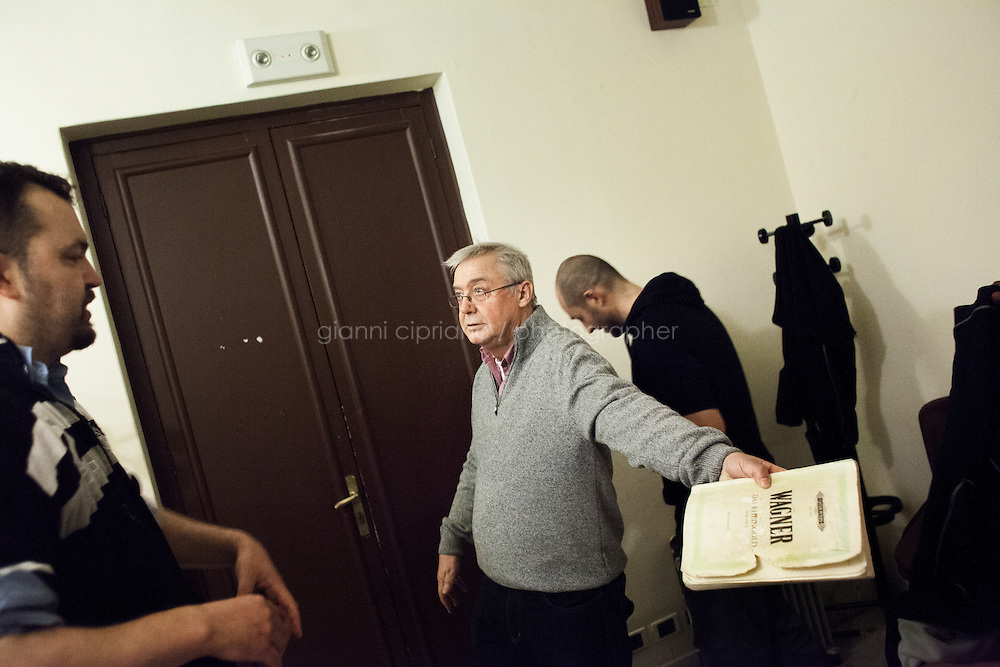 PALERMO, ITALY - 20 JANUARY 2013: Director of Das Rheingold Graham Vick (center), with his assistant on the right, gives suggestions to  Christian Hübner, interpreting the giant Fafner, in a dressing room before starting the rehearsal of Das Rheingold at the Massimo Theatre in Palermo, Italy, on January 20th 2013...Das Rheingold is the first of the four operas that constitute Richard Wagner's Der Ring des Nibelungen ('The Ring of the Nibelung'). It was originally written as an introduction to the tripartite Ring, but the cycle is now generally regarded as consisting of four individual operas. Das Rheingold received its premiere at the National Theatre in Munich on 22 September 1869.